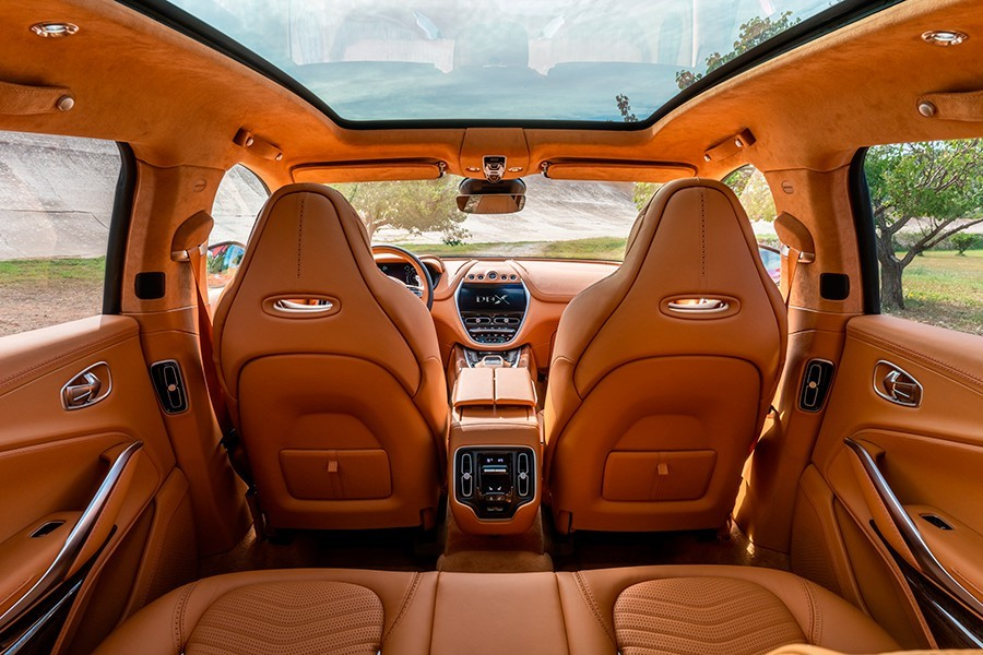 The interior of the Aston Martin DBX is luxurious and sporty as always in the brand, but now, in addition, spacious and bright.